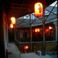 Photo taken at Qianmen Hostel by Jannes P. on 6/29/2014