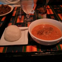 Photo taken at Ghana Cafe by Noriko K. on 6/16/2013