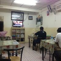 Photo taken at Al Madina Restaurant by Surmed B. on 6/16/2013