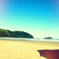 Photo taken at Praia da Baleia by Luciana P. on 7/28/2013
