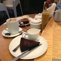 Photo taken at Kala Ghoda Café by Andrea O. on 7/2/2013