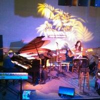 Photo taken at Snug Harbor Jazz Bistro by Lisa on 11/27/2012