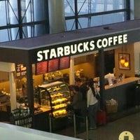 Photo taken at Starbucks Coffee 関西国際空港エアサイド店 by Tatsuya D. on 12/18/2011