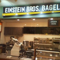 Photo taken at Einstein Bros Bagels by sunny on 7/26/2012
