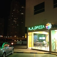 Photo taken at N_K_DPIZZA: Dubai Marina by Raza A. on 4/5/2012