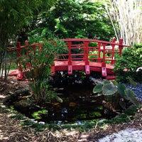 Photo taken at Miami Beach Botanical Garden by Nara C. on 7/25/2013