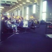 Photo taken at Gate 23 by Vitaliy C. on 4/8/2013