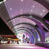 Photo taken at Dubai International Airport (DXB) by Guennadi M. on 10/5/2013
