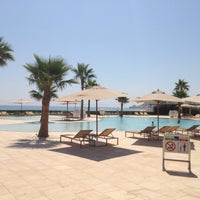 Photo taken at Mövenpick Hotel Gammarth Tunis by Fabien C. on 7/24/2013