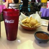 Photo taken at Mangos Mexican Café by Diana O. on 8/12/2013