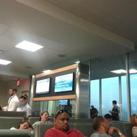 Photo taken at Gate 26 by Adriana R. on 7/23/2013