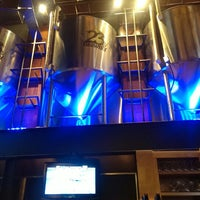Photo taken at 23rd Street Brewery by Luis G. on 7/28/2013