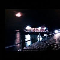 Photo taken at Derawan Beach Cafe & Cottage by Ong T. on 9/13/2014