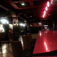 Photo taken at Al Asador Restaurant by Juan T. on 8/19/2013