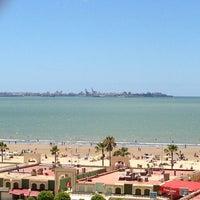 Photo taken at Playa de Valdelagrana by Lourdes on 7/28/2013