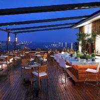 Photo taken at Conrad Teras Restaurant by Juliana M. on 5/23/2014