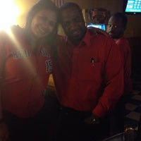 Photo taken at Spectators Sports Pub by Justina R. on 2/8/2014