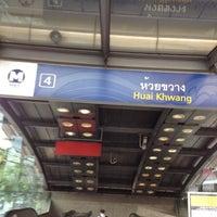Photo taken at MRT Huai Khwang (HUI) by Ben P. on 6/27/2012