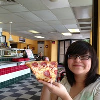 Photo taken at Carmine's Pizzeria by Isaac R. on 8/8/2013