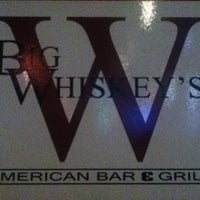 Photo taken at Big Whiskey's American Bar & Grill by Amanda C. on 3/27/2013