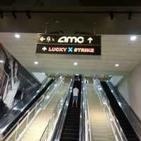 Photo taken at AMC River East 21 by Yesenia A. on 8/16/2013