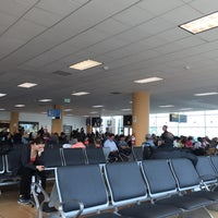 Photo taken at Puerta / Gate 11 by Jantima T. on 4/27/2015