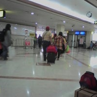 Photo taken at Gate 6 by Yuniea A. on 2/1/2014