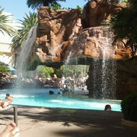 Photo taken at The Mirage Waterfall by Laura S. on 6/26/2013