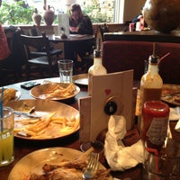 Photo taken at Nando's by Xel D. on 1/13/2013