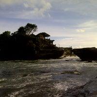 Photo taken at Tanah Lot Beach by Angga P. on 1/21/2013