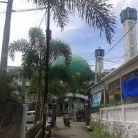 Photo taken at Masjid Agung Syi'arul Islam by Sathya B. on 1/10/2014