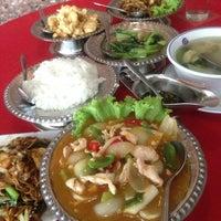 Photo taken at Sintawang Seafood Restaurant by Kensuke on 9/8/2014