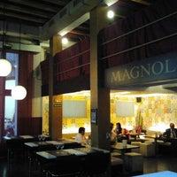 Photo taken at Magnolia Restaurant by Judit A. on 5/15/2013
