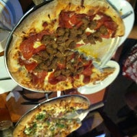 Photo taken at Oggi's Pizza & Brewing Company by Diz N. on 1/17/2013