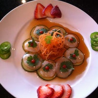 Photo taken at Sweet Ginger Asian Bistro & Sushi by Beth W. on 5/6/2013