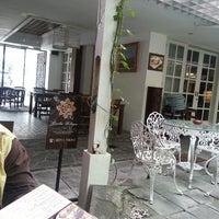 Photo taken at Goela Klapa Restaurant by Tjatur U. on 2/19/2014