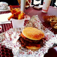 Photo taken at Five Guys by Hiroshi E. on 7/20/2013