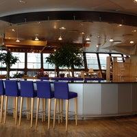 Photo taken at British Airways Terraces Lounge by Ben W. on 9/11/2013