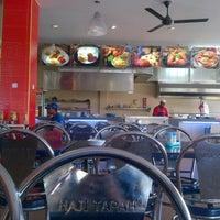 Photo taken at Restoran Nasi Kandar Haji Tapah by Brown S. on 12/4/2012
