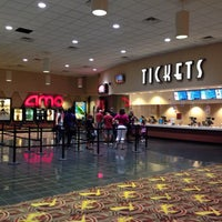 Photo taken at AMC River East 21 by Ross G. on 8/12/2013