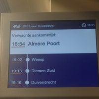 Photo taken at Bushalte Station Muziekwijk by Lieng N. on 12/31/2013