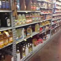 Photo taken at Food 4 Less by Nathalie on 8/4/2012