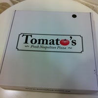 Photo taken at Tomato's Fresh Neopolitan Pizza by Eileen on 5/16/2012
