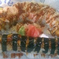 Photo taken at Sushi Moto by David B. on 3/20/2012