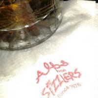 Photo taken at Alps Restaurant & Beer Bar by Chetna P. on 7/7/2014