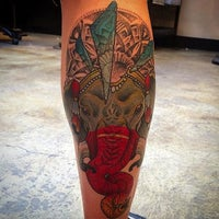 Photo taken at Under the Needle Tattoos by Josh S. on 8/30/2015