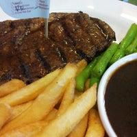 Photo taken at Holycow! Steakhouse by Jihan Y. on 12/8/2012