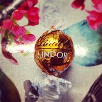 Photo taken at Lindt Chocolate Studio by Avinia N. on 3/28/2014