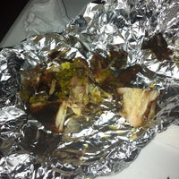 Photo taken at Sweetwood Jerk Joint by Angel H. on 7/1/2014