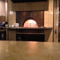 Photo taken at Olio Wood Fired Pizzeria by Aaron H. on 12/22/2012